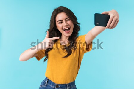 Image of posh attractive woman 20s with beautiful makeup holding Stock photo © deandrobot
