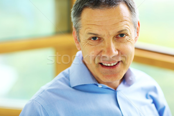 Portrait of a man with grey hair looking to the camera Stock photo © deandrobot