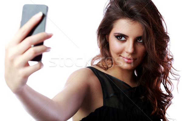 Happy woman taking self picture with smartphone camera Stock photo © deandrobot