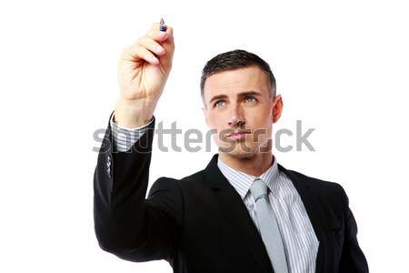 Businessman writes with pen at copyspace over white background Stock photo © deandrobot