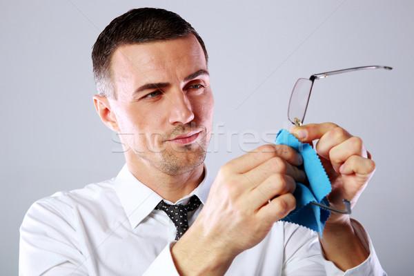Stock fotó: Jóképű · üzletember · szemüveg · rongy · szürke · arc