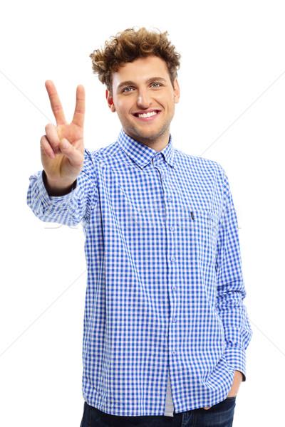красивый молодым человеком победу пальцы знак Сток-фото © deandrobot