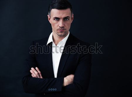 Portrait of a confident businessman with arms folded Stock photo © deandrobot