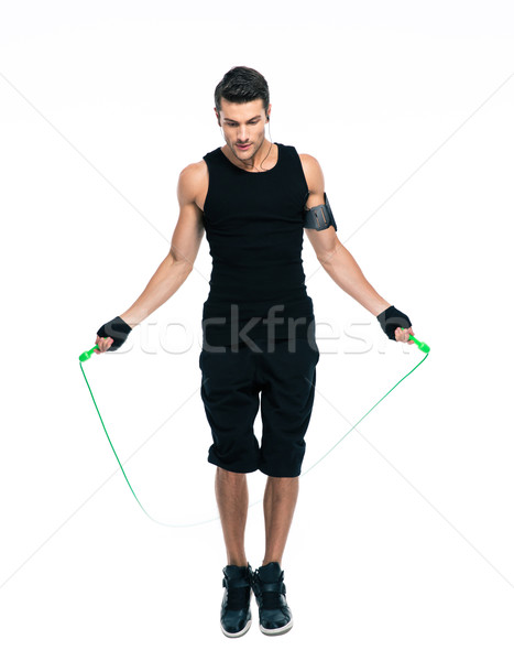 Sports man jumping with skipping rope Stock photo © deandrobot