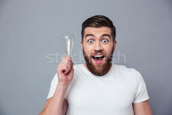 Portrait homme ampoule gris Photo stock © deandrobot