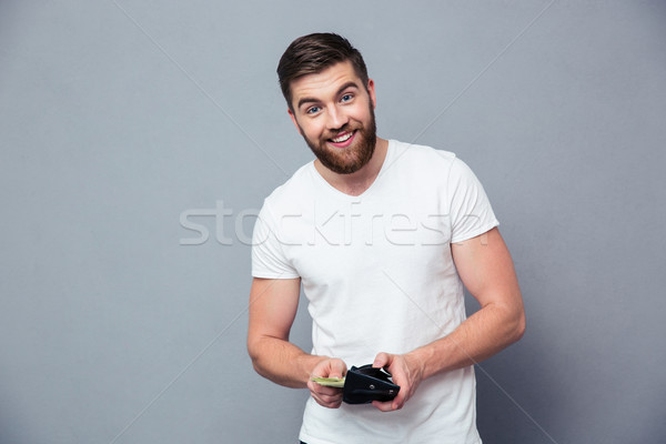 Portre mutlu adam cüzdan para Stok fotoğraf © deandrobot