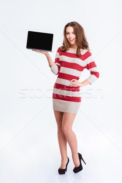 улыбающаяся женщина портативного компьютера экране портрет Сток-фото © deandrobot