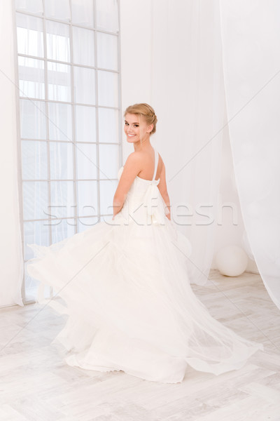 Happy bride standing in white wedding dress Stock photo © deandrobot