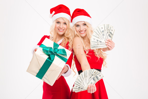 Two sisters twins in red santa claus costumes and hats  Stock photo © deandrobot