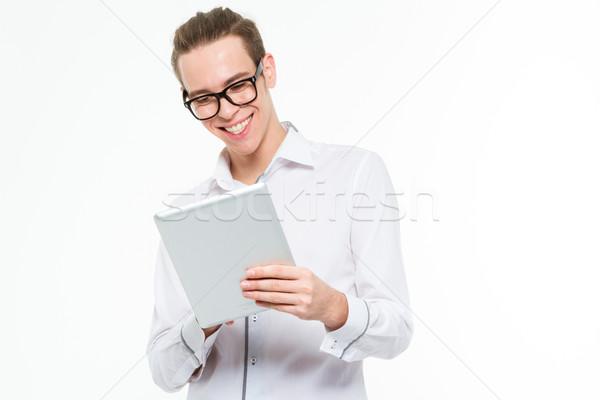 Smiling businessman using tablet computer Stock photo © deandrobot