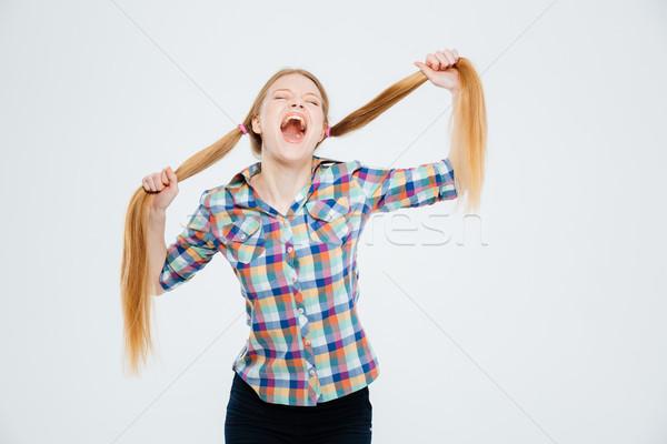 Nő tart sikít fiatal nő izolált fehér Stock fotó © deandrobot