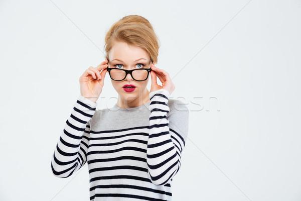 Fiatal nő felfelé néz izolált fehér nő lány Stock fotó © deandrobot