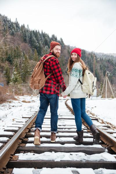 Glimlachend paar lopen spoorweg bos Stockfoto © deandrobot