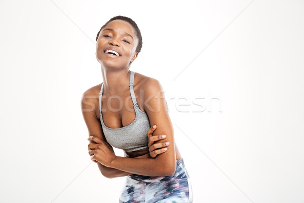 Cheerful  young african american sportswoman posing with hands folded  Stock photo © deandrobot