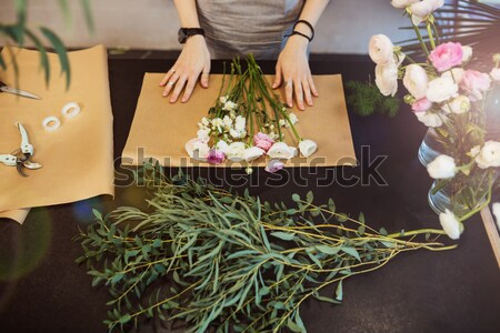 Homme fleuriste noir table haut Photo stock © deandrobot