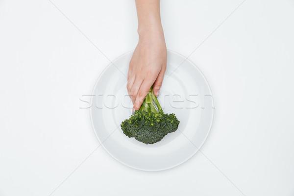Top view donna mano broccoli piatto Foto d'archivio © deandrobot