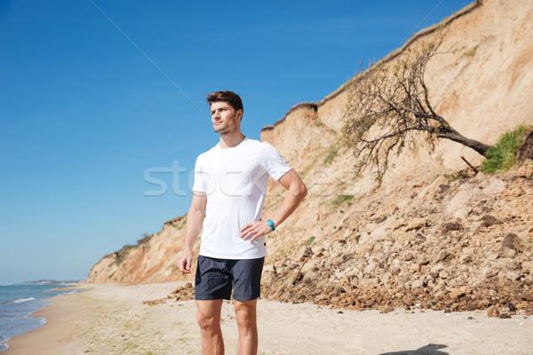 çekici genç ayakta plaj düşünme Stok fotoğraf © deandrobot