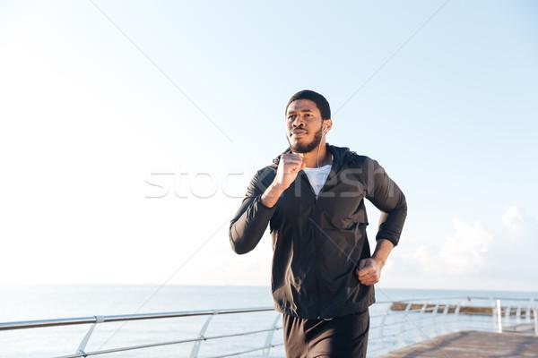 アフリカ 男 音楽を聴く を実行して 桟橋 クローズアップ ストックフォト © deandrobot
