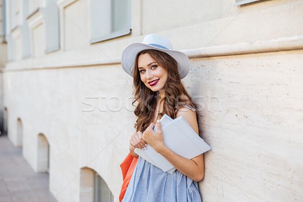 Feliz mulher em pé dois coberto Foto stock © deandrobot