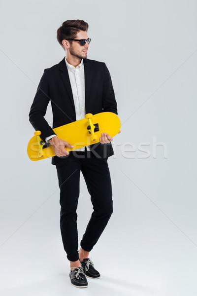 Jeunes élégant affaires costume jaune Photo stock © deandrobot