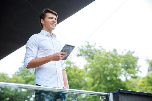 Boldog üzletember áll erkély tabletta fiatal Stock fotó © deandrobot