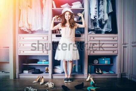 Lány választ cipők ruhásszekrény fiatal töprengő Stock fotó © deandrobot