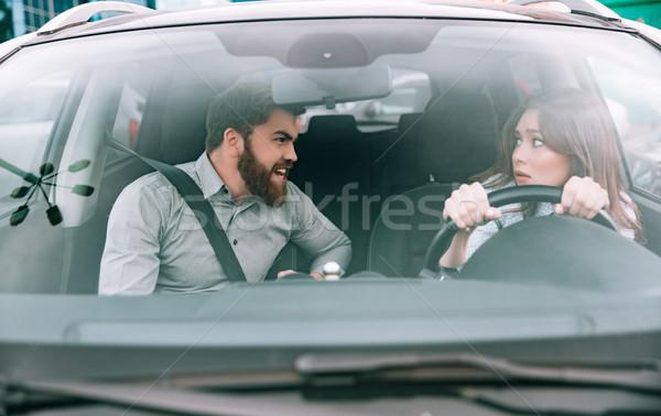 Lány kerék férfi autó ijedt szemek Stock fotó © deandrobot