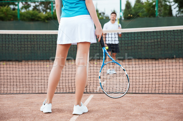 Tennis players playing a match on the court Stock photo © deandrobot