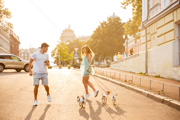 Couple running with their dogs walking outside Stock photo © deandrobot