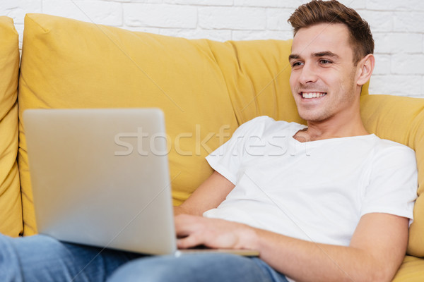 Homem sessão sofá laptop escritório negócio Foto stock © deandrobot