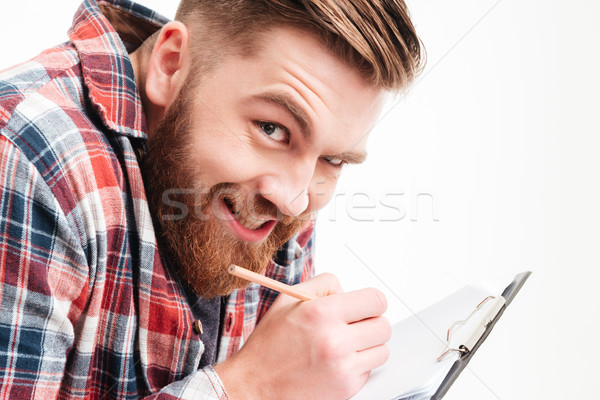 Férfi készít vicces arc ír vágólap közelkép Stock fotó © deandrobot