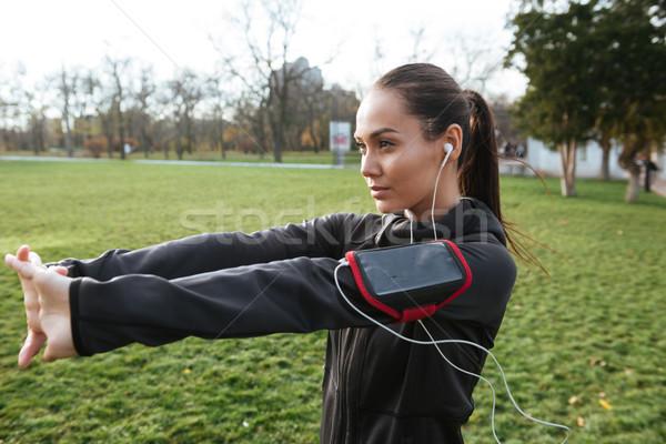 Stock photo: Lady runner in autumn park make sport exercise