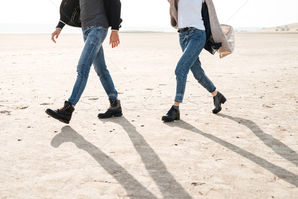 Cropped image of a couple standing together at the seashore Stock photo © deandrobot
