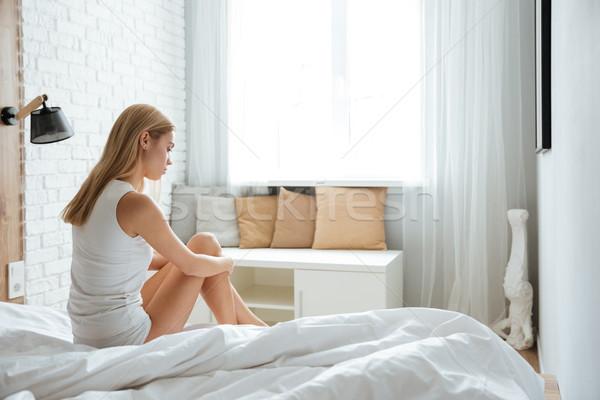 Dalgın bunalımlı genç kadın oturma düşünme yatak Stok fotoğraf © deandrobot