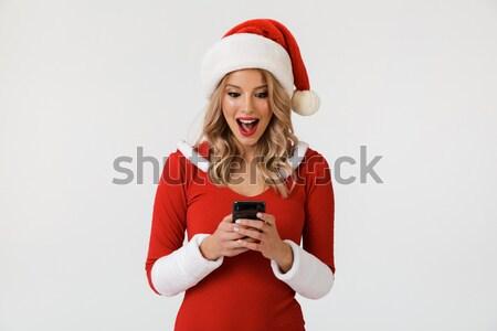 Gülen güzel bir kadın noel baba şapka cep telefonu güzel Stok fotoğraf © deandrobot