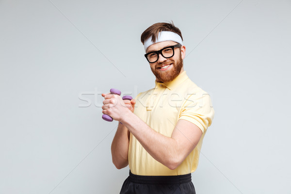 Funny male nerd with dumbbells Stock photo © deandrobot