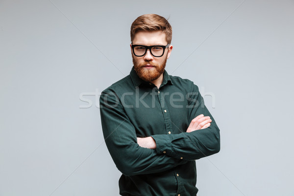 Serious Bearded man in shirt and eyeglasses Stock photo © deandrobot