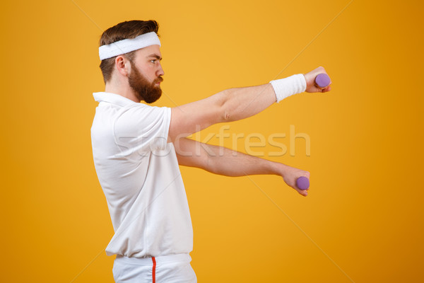 Side view of sportsman with lightweight dumbbells Stock photo © deandrobot