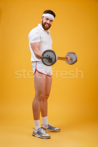 улыбаясь бородатый человека тренировки штанга Сток-фото © deandrobot