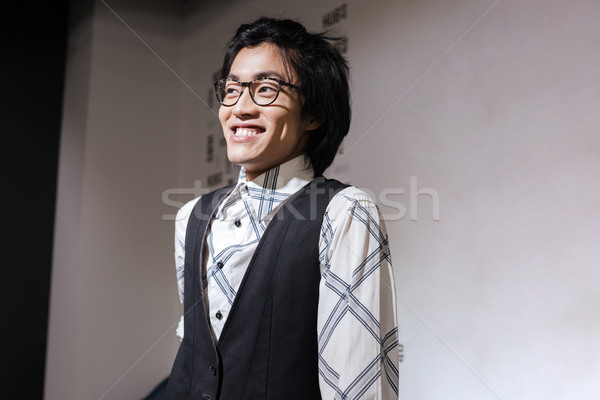 Amazing young asian man looking aside. Coworking concept. Stock photo © deandrobot
