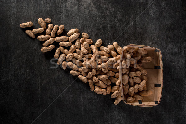Top view photo of dried peanuts on dark background Stock photo © deandrobot