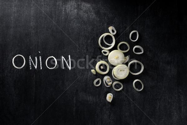 Görüntü kesmek soğan karanlık kara tahta üst Stok fotoğraf © deandrobot