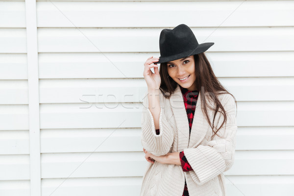 Cheerful young caucasian lady walking outdoors at beach Stock photo © deandrobot