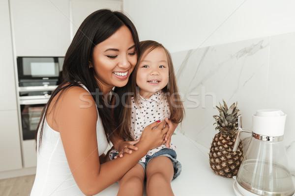 Boldog mosolyog ázsiai nő lánygyermek nevet Stock fotó © deandrobot