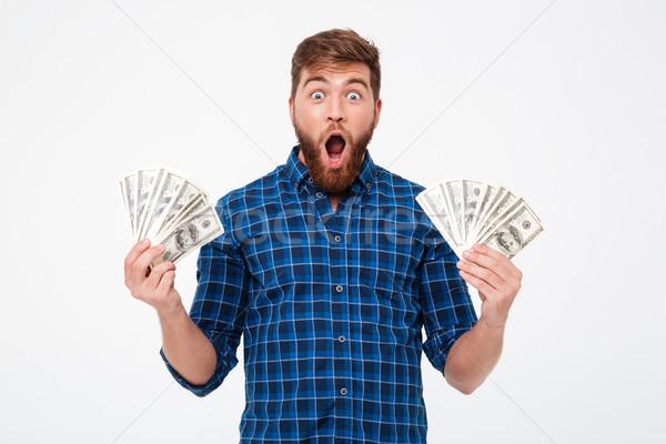 Screaming bearded man in checkered shirt holding money Stock photo © deandrobot