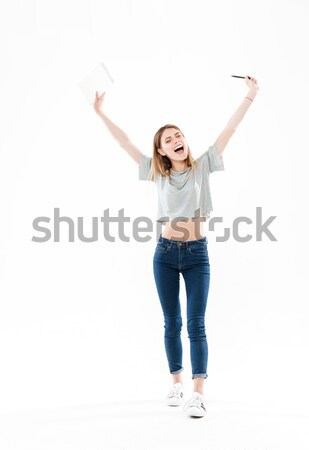 Full-length shot of young smiling girl showing at copy space Stock photo © deandrobot