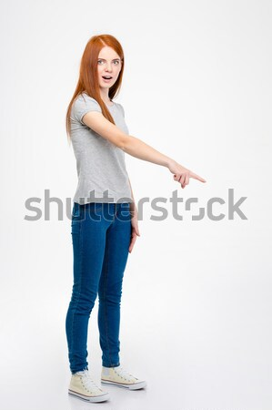 Portrait of a happy excited girl standing and celebrating success Stock photo © deandrobot