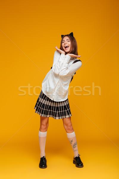 Porträt freudige jugendlich Schülerin einheitliche Stock foto © deandrobot