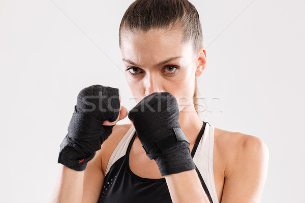 Close up portrait of a concentrated focused sportswoman Stock photo © deandrobot