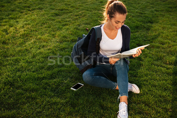 Portrait of a casual young student girl with backpack Stock photo © deandrobot
